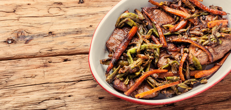 Beef steaks stewed in carrots and green beans