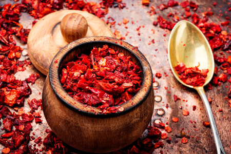 Sweet red sliced pepper as seasoning. Spice for meat dishes