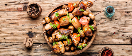 Meat chicken shish kebab with mushrooms and spices.Eastern food Stock Photo