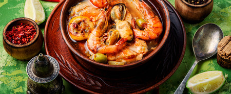Seafood soup with prawns, mussels and fish.Delicatessen food
