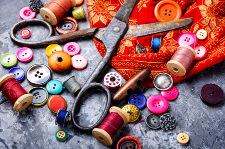 Composition with threads and sewing accessories.Sewing kit Archivio Fotografico