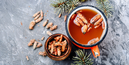 Tea with pine buds for treating colds.