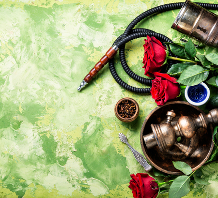 Hookah with rose aroma for relax. Stockfoto