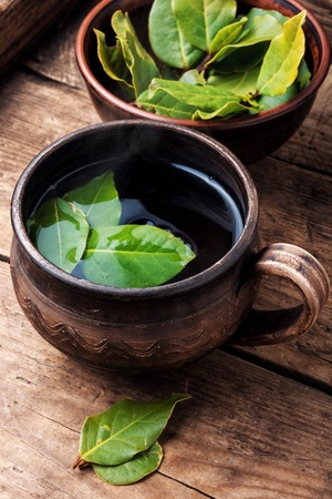 Herbal tea with bay leaf on wooden background.Slimming tea