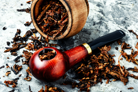 Tobacco pipe or smoking pipe.Classic wooden pipe with tobacco