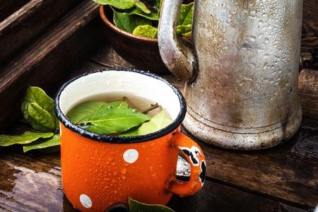 Herbal tea with bay leaf on wooden background.Slimming tea
