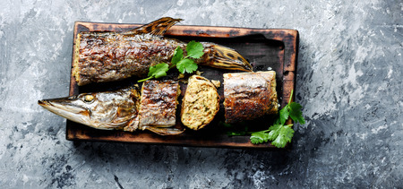 Baked grilled fish.Pike fish stuffed with mushrooms.Pike royally. Russian cuisine
