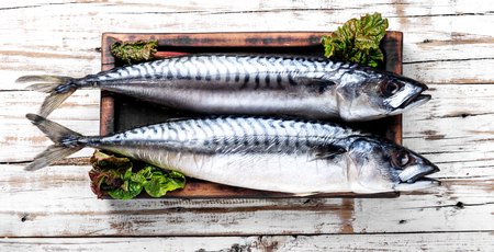 Salted mackerel on a kitchen board.Smoked mackerel.Seafood