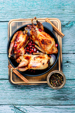 Quail roasted with pomegranate sauce in frying pan