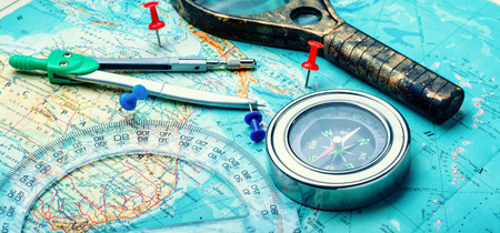 Retro compass with vintage map.Travel planning concept on map