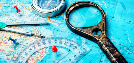 Retro compass with vintage map.Compass and magnifying glass on the old map