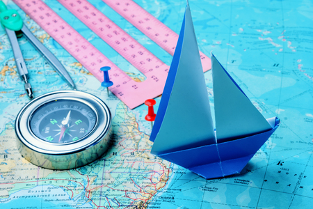 Retro compass with vintage map.Magnetic compass on a world map