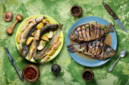 Fish dish-fried fish with vegetables.Roasted fish.Flat lay