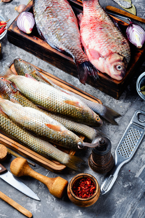 Seafood.Board with fresh fish and spices.Raw fish cooking and ingredients.