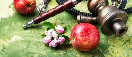 Modern fruit Hookah.Eastern shisha with apple.