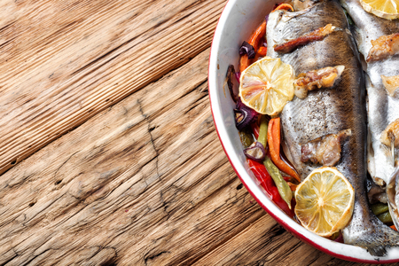 Trout with bacon baked in the oven. Fish with vegetables