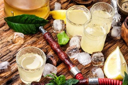 Smoking hookah and glasses with alcoholic lemon