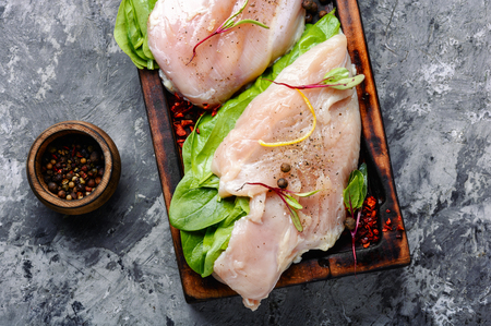 Fresh raw chicken on kitchen cutting board
