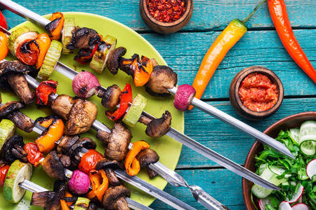 Skewers of grilled vegetables.Vegetable kebabs with peppers, mushrooms, zucchini and tomatoes