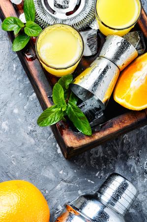 Orange cocktail with lime slice and ice.Glass of orange drink Reklamní fotografie