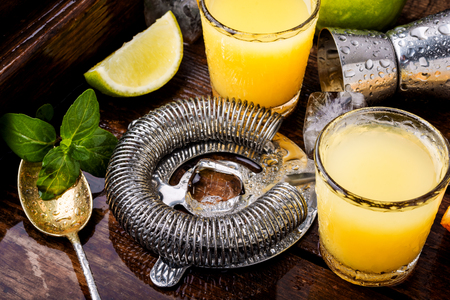 Glass of orange drink.Alcoholic drinks on rustic wood background.Drink background Imagens
