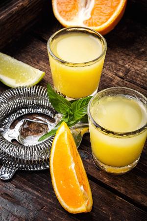 Glass of orange drink.Alcoholic drinks on rustic wood background.Drink background Reklamní fotografie