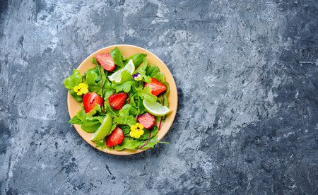 Light salad with greens, strawberries and lime.Summer food.Health food