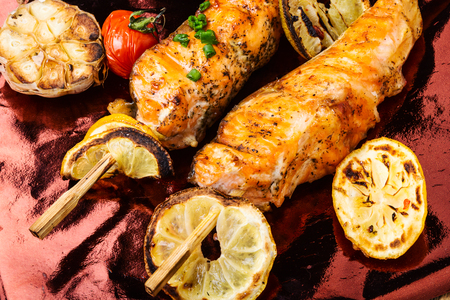 Grilled fish, grilled salmon steak with addition of lemon.Closeup