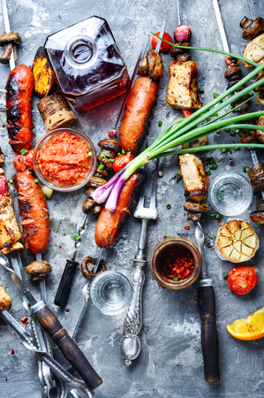 Assortment of grilled dishes, kebabs, sausages and grilled vegetables