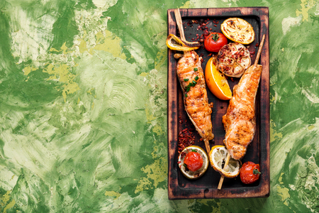 Barbecue skewers with fish.Grill salmon shish kebab