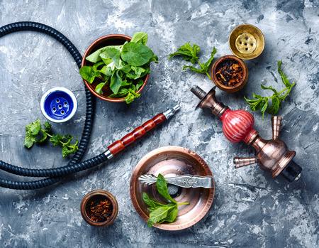 Oriental smoking hookah with mint flavor.Shisha mint tobacco.Shisha hookah with spearmint
