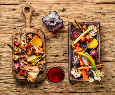 Grilled chicken wings with grilled vegetables.Chicken wings on barbecue grill