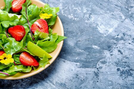 Salad with greens, strawberries and lime.Summer food.Healthy food