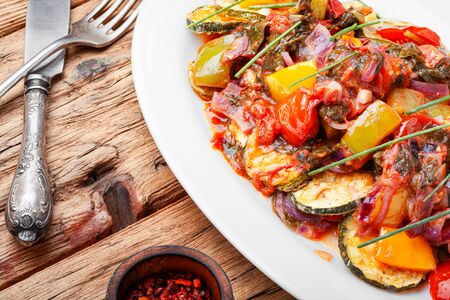 Grilled zucchini in Greek.Greek cuisine.Steamed vegetables.Summer food Imagens