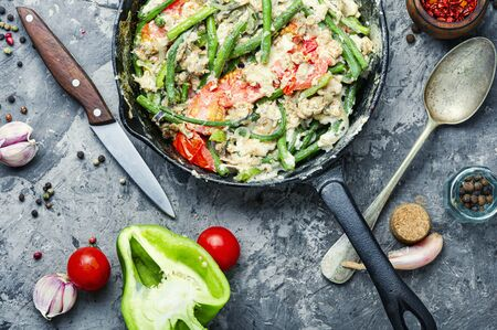 Protein scrambled eggs with asparagus beans. Fried eggs with vegetables