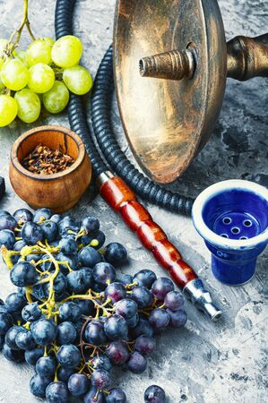 Turkish tobacco hookah with grapes aroma.Kalian with berry