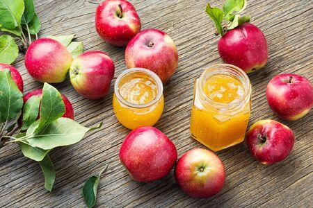 Jam from red apples.Apple jam.Autumn dessert on wooden table 写真素材 - 128905871