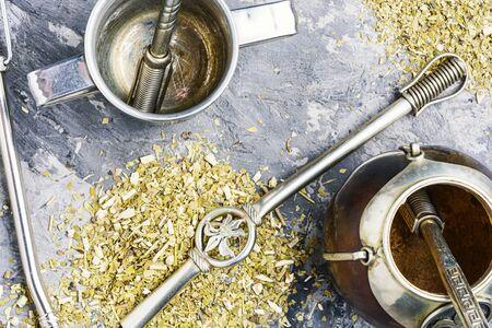 Yerba mate tea popular in latin america.Yerba mate in calabash and dry herb.