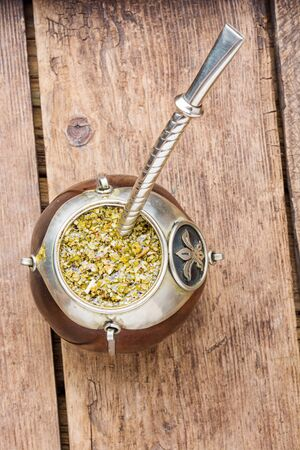 Yerba mate in calabash and dry herb.Traditional argentinian beverage
