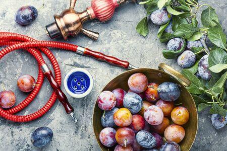 Tobacco shisha with plum flavor.Nargile with plum.Turkish fruit hookah tobacco Banque d'images - 129325949