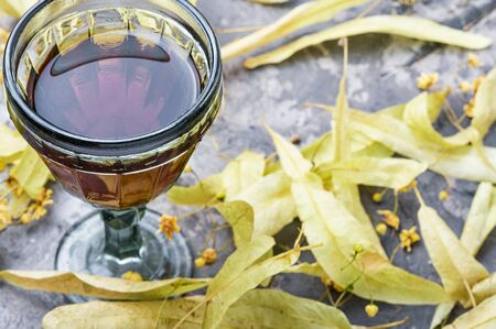 Herbal medicine.Healing tincture or decoction of linden flowers