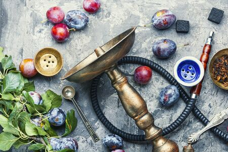 Tobacco shisha with plum flavor.Nargile with plum.Turkish fruit hookah tobacco Imagens