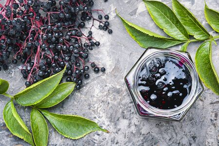 Elderberry jam and fresh berries.Homemade pozzy.Marmalade or confiture Stock fotó