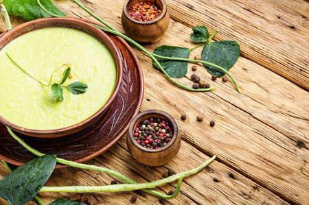 Green asparagus bean soup.Vegetable soup.Diet food.Space for text