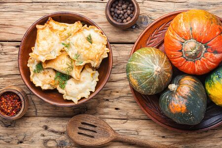 Traditional autumnal pumpkin dumplings.Fried pumpkin vareniki.Autumn food