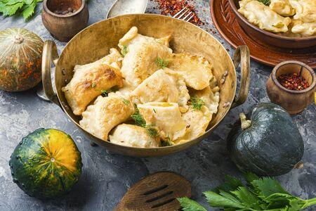 Traditional pumpkin dumplings or vareniki.Fried pumpkin vareniki.Autumn food
