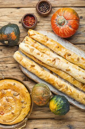 Moldovan pie made of yeast puff pastry.Pie with pumpkin.Placinta