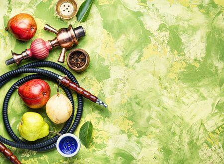 Smoking hookah.Details of Turkish kalian.Shisha with a fruity aroma of tobacco.Flat lay