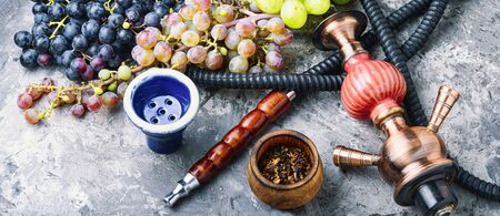Smoking hookah.Details of Turkish kalian.Shisha with a fruity aroma of tobacco. Imagens