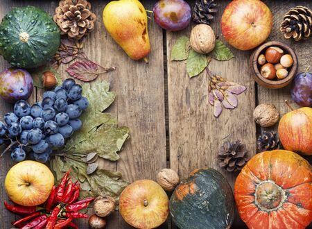 Pumpkins,nut and fruits in autumn still life on wooden table.Fall still life 版權商用圖片